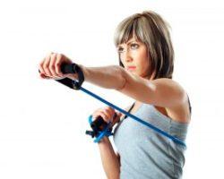 bigstock-Sportswoman-With-Resistance-Ba-6291094-300x214